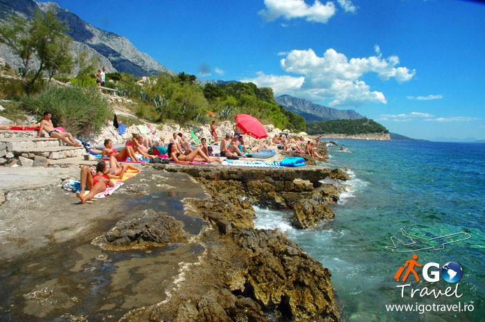 sunbathing on rocky beach makarska riviera