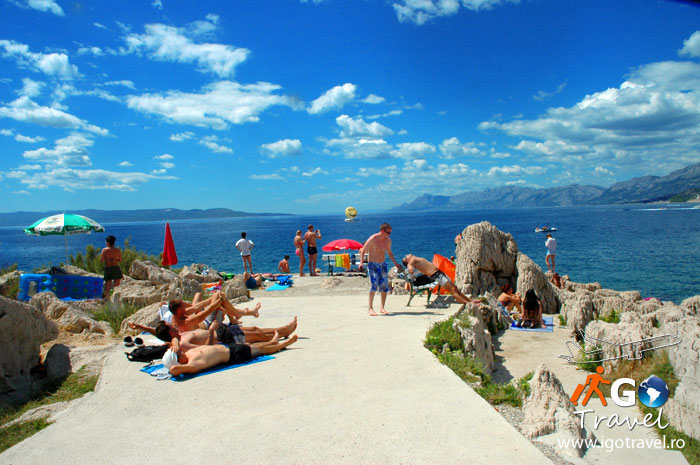 tourist sunbathing makarska beach