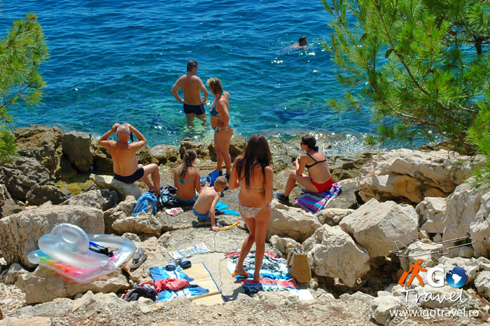 tourists sunbathing swimming makarska